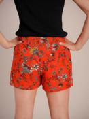 Redish orange floral shorts with metalic thread detail. Elastic waist