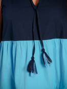 It's so easy to look cool and pretty in this beachy 3-color dress! V-neck opening; ruffle around collar with 2-color tassles hanging from matching fabric ties; sleeveless; three colors pleated at horizontal seams