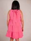 Ruffle collar; sleeveless; wide ribbon tie at back of neck; pleated horizontal seams across body of dress