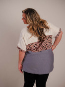 Light tan linen at top, rose and black leopard print at middle of shirt and bottom of short sleeves, gray at bottom third