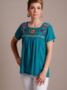 Woman Models Teal Embroidered Floral Top
