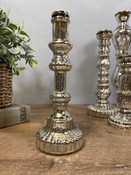 """Antiqued silver mirror glass taper candle holder. 10 1/4"""" tall; base is about 4"""" round."""