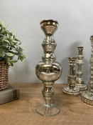 """Antiqued silver mirror glass taper candle holder. 12 1/2"""" tall; base is about 3 1/2"""" round."""