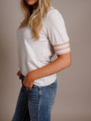 white tee with striped sleeve