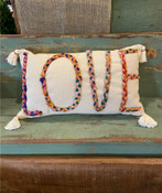 """Multi-color Chindi fabric """"LOVE"""" applique on 24""""L x 14""""H cotton lumbar pillow. Insert included. Each Chindi fabric applique is unique; this one features some mustard yellow."""