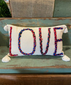 """Multi-color Chindi fabric """"LOVE"""" applique on 24""""L x 14""""H cotton lumbar pillow. Insert included. Each Chindi fabric applique is unique; this one features rose pink and red fabrics."""