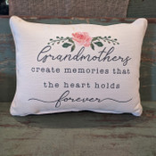 """The perfect way to cozy up any space! """"Grandmothers create memories that the heart holds forever"""" sentiment is dyed directly into the fabric, so it won't peel or crack; soft white piping around the edge for an extra pop! Made from a soft yet durable polyester fabric, your pillow will arrive stuffed with poly-fill and sewn shut. Approx. 20"""" W x 14"""" H; machine washable in cold water, delicate cycle- fluff, air dry flat."""