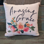 """The perfect way to cozy up any space! """"Amazing Grace"""" sentiment and floral design are dyed directly into the fabric, so it won't peel or crack. Made from a soft yet durable polyester fabric, your pillow will arrive stuffed with poly-fill and sewn shut. Approx. 17"""" square; machine washable in cold water, delicate cycle- fluff, air dry flat."""