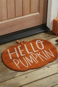 """Woven coir pumpkin shaped doormat. 22"""" x 26 1/2""""."""