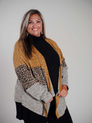 Heathered orange and gray at top, brown and black leopard print on heathered tan background at middle of cardigan, and heathered cream and gray at bottom third.