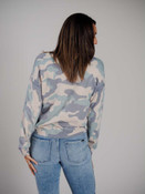 Gray and powder green/blue camo print on soft taupe sweater. Wide v-neck and long sleeves