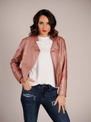 Buttery soft faux leather jacket in metallic rose with silvertone hardware and stitched details. Low collar, buttoned open at neck, zipper close offset to the left, angled zipper pockets on front, long sleeves with zippers at wrists, fully lined