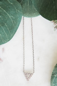 """White gold dipped dainty necklace attached to down-pointing triangle charm made up of 10 tiny gems in round mountings. Adjustable from 16"""" - 18"""" with lobsterclaw clasp. Heart charm at clasp. Nickel and lead free."""