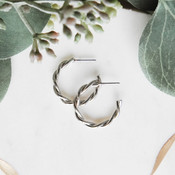 """Shiny silver-tone twisted hoops. 7/8""""; post back; nickel and lead free."""
