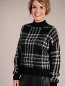 Black sweater with white houndstooth plaid stripes