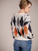 Off-white sweater with navy, gray, and pumpkin argyle pattern