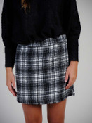 """Soft white/black plaid skirt. Zipper and hook/eye close at left side, darted in back for shape, fully lined, 16"""" long"""