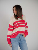 Light weight loose knit natural beige colored sweater with bright pink stripes. Bright pink at the wide round neck, long sleeves
