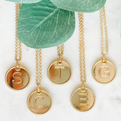 """Gold-tone necklace and 3/4"""" circle charm with embossed initial (available letters: A B C E G H J K L M N P R S T). Adjustable from 17 3/4"""" - 20 1/2"""" with lobsterclaw clasp. Nickel and lead free."""