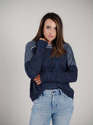 Navy and multi-color knit sweater with raw-edged lightweight denim-look accent fabric at shoulders and around neck