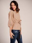 Beige dolman sleeve blouse with 3/4 length sleeve pleated at cuff, wide round neck, elastic waist with belt to tie at waist