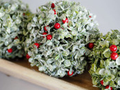 glittered green mistletoe ornament with red berries