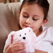 """All age groupscan have hours of funusingtheirWarmies®Cozy Plush Junior Bunny,knowing that they can be warm all night long.  The 9"""" Junior Bunnyisfully microwavable yet entirely safe to hold tight after taking abath, putting onPJs,and headingup the stairs to bed."""