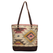 Leather, canvas & rug tote. The front has a natural, red, gold, brown and grey southwestern print with a main zipper closure. The back is solid canvas with a pocket and zipper. Interior has double open pockets and a single pocket with zipper.