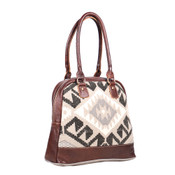 Leather, canvas & rug tote.  The front has a natural, grey and black print with a main zipper closure.  The back is solid canvas.   Interior has double open pockets and a single pocket with zipper.
