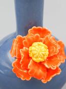 ceramic blue bud vase with orange flower
