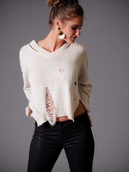 beige v-neck distressed cream sweater