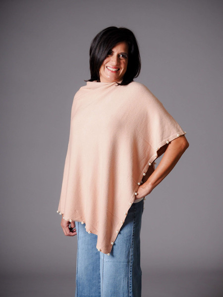 ballet pink knit poncho with pearl detail