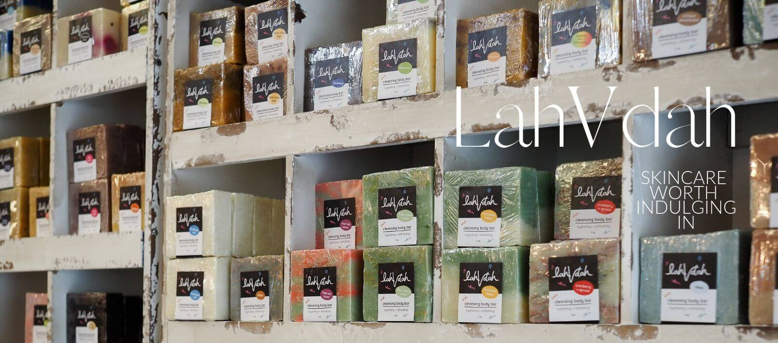 A Wall Stacked Full of LahVDah Handmade Soaps