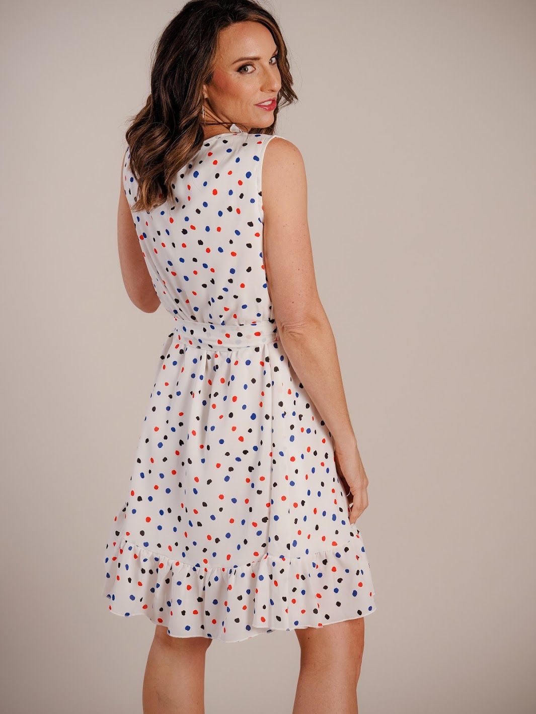 white dress with red and blue polka dots
