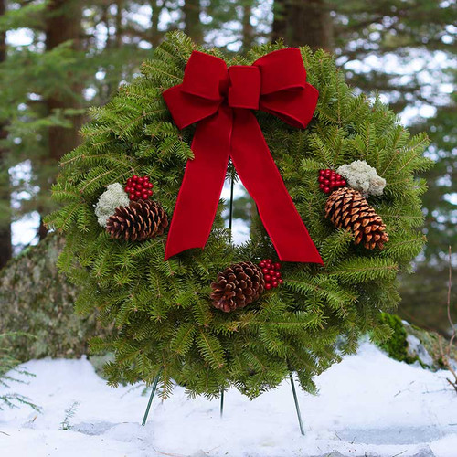 Acadia Fresh Christmas Wreath made from Balsam Fir, decorated with pine cones, reindeer moss, red berries, and a hand-tied deep red velvet bow from Harbor Farm in Maine