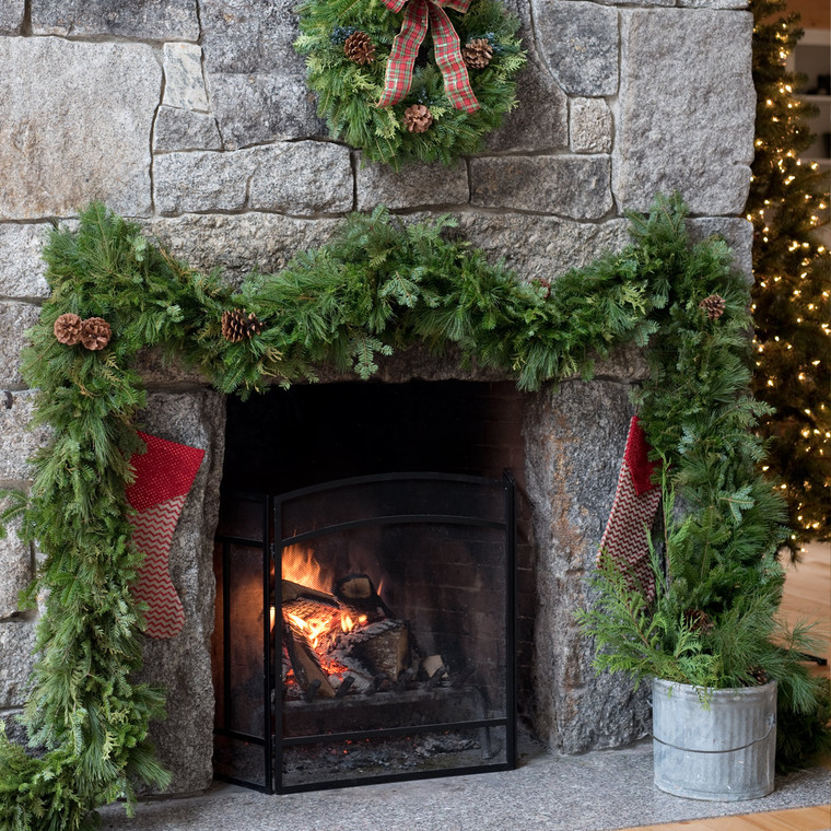 Fresh mixed evergreen Christmas garland made of balsam, pine, and cedar