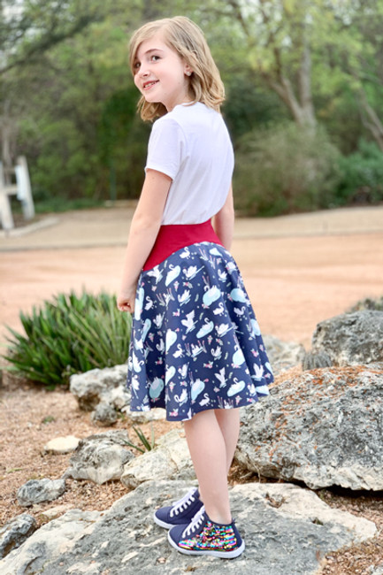 Girls size 2-16 modern PDF sewing pattern.  Trendy skirt/Skort with 2 length options for wovens or knits.