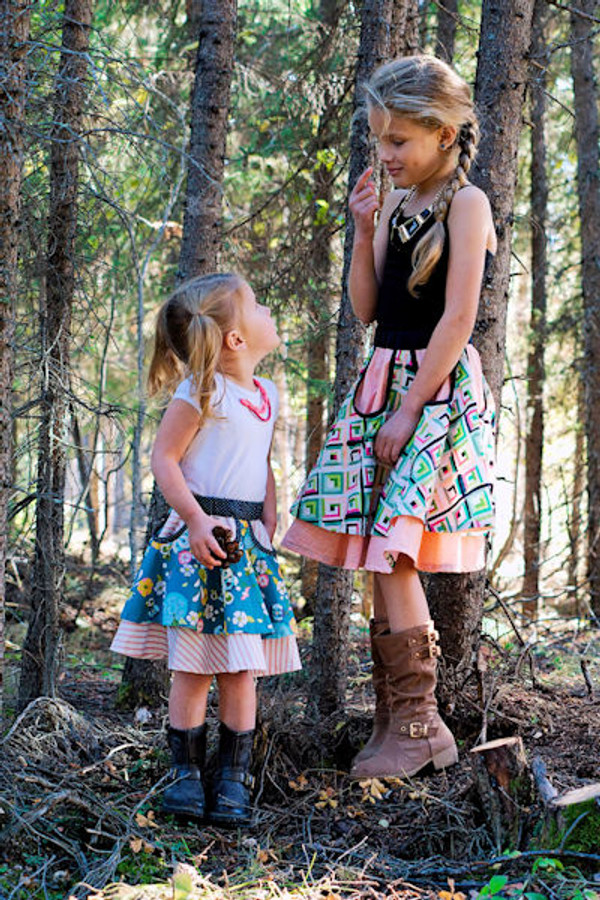 Double layered circle skirt with unique cut out detail.  Girls PDF sewing pattern