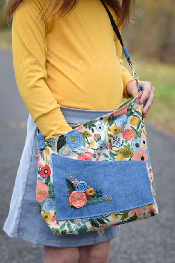 Angled cross body bag/purse with outer pocket and adjustable strap. PDF sewing pattern