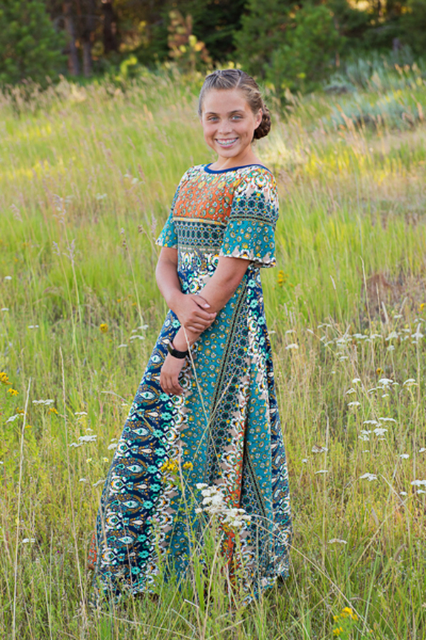 The Miss Dandelion dress from the Junior miss size chart by Sofiona Designs. Picture showing the maxi length and optional sleeves.