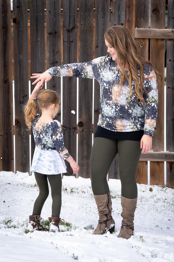 The girls' Tundra in crop length and 3/4 length cuffed sleeves and junior Miss Tundra in hip length and long sleeves.