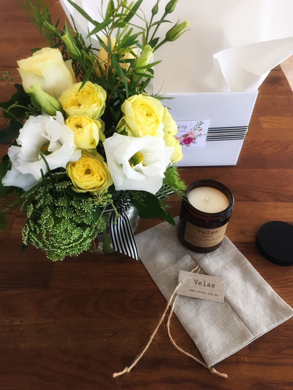 Vase of Flowers and Candle