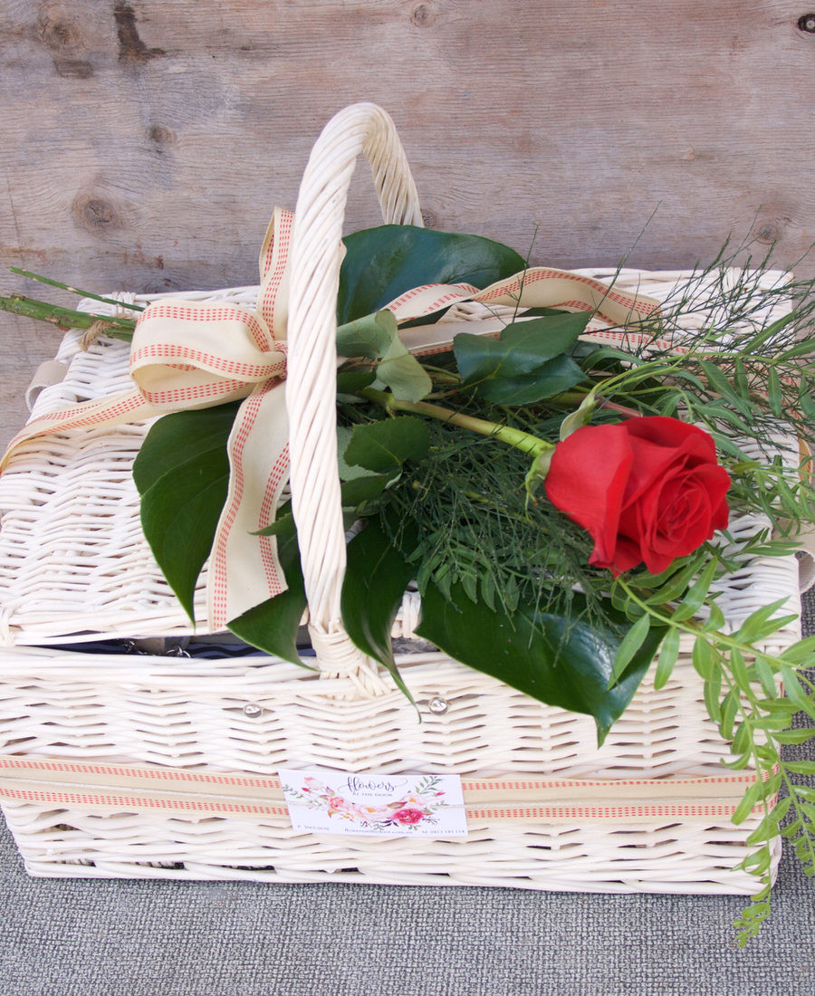 Picnic Basket With Red Rose Flowers At The Door