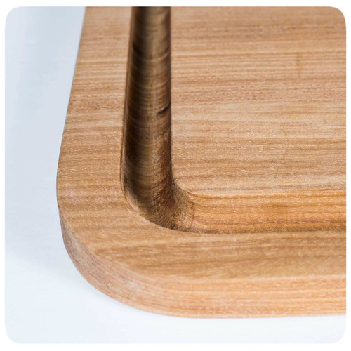 The PK Grills Durable Teak Cutting Board has a deep moat to catch juices.