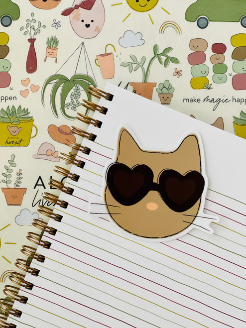 adhesive sticker in the shape of a cat with sunglasses on