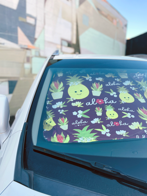 sun shade in car with pineapples and flowers on it