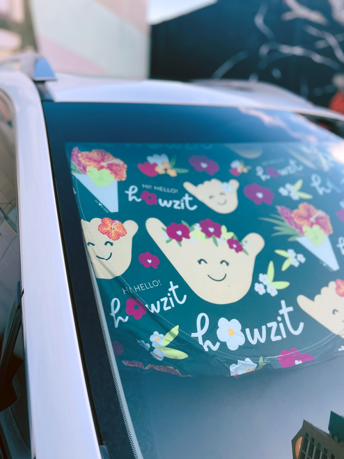 sun shade with shakas and flowers on it