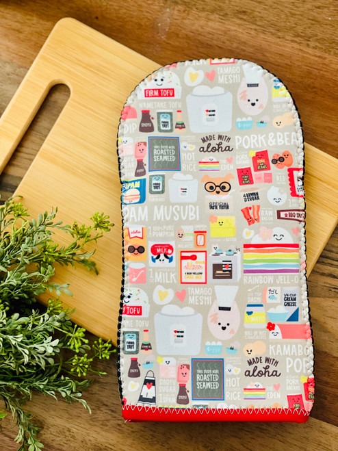 oven mitt with food icons on it