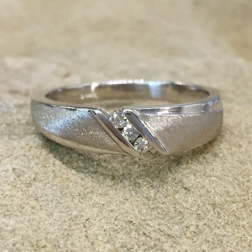 The MATT wedding band features 3 channel-set round brilliant diamonds.