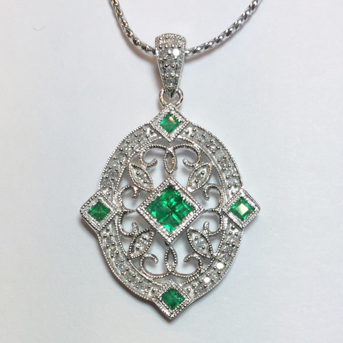 This emerald and diamond pendant features 8 princess cut natural earth-mined emerald and round brilliant diamonds